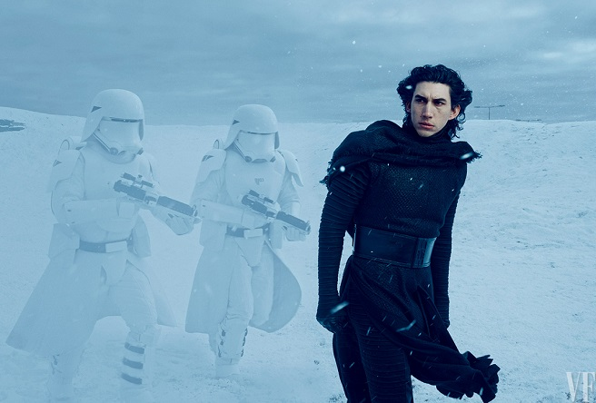An unmasked Kylo Ren (Adam Driver) leads two stormtroopers